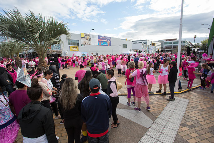 Thousands don pink for breast cancer walk